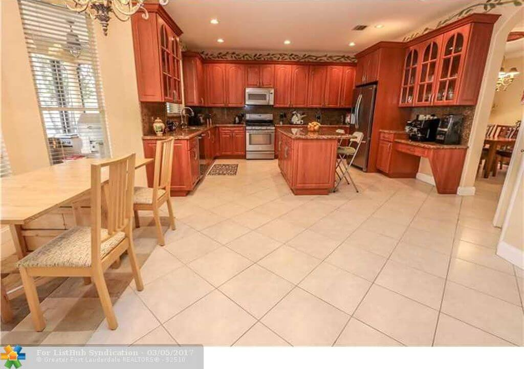 Wood and Cream Tile Kitchen and Dining