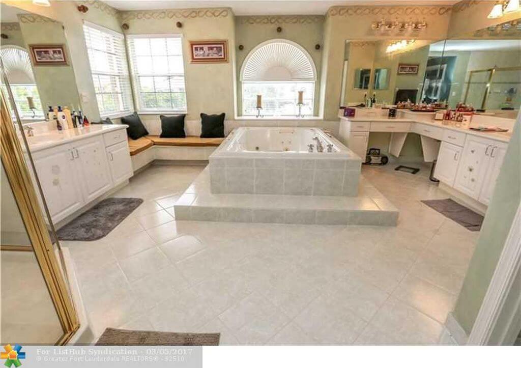 Bathroom with Sink bathtub and sofa